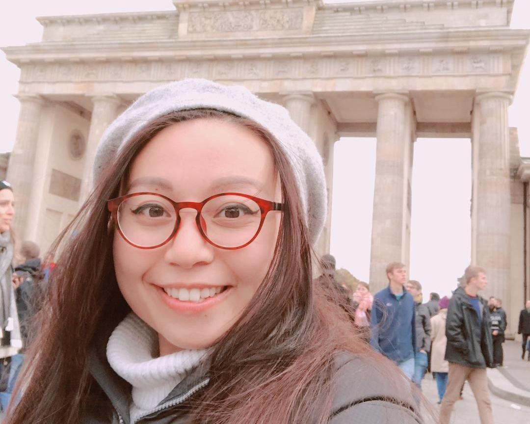 Graduate School of Business student Nguyen Tram in front of Germany\'s Brandenburg Gate